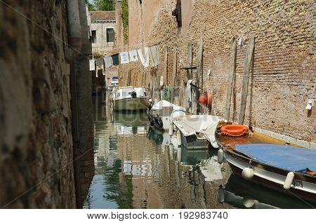 VENICE, ITALY - CIRCA 2013: The historic city of Venice with its ancient buildings on canals and boats