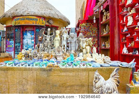 Sharm El Sheikh, Egypt - April 13, 2017: Alabaster cats and statuettes in Egyptian souvenir shop at Sharm El Sheikh, Egypt on April 13, 2017