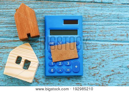 Wood House And Calculator With Blank Card