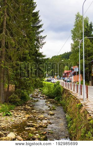 Background landscape view of a mountain stream in the resort of Pec pod Snezkoy, on the border of the Czech Republic and Poland