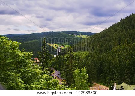 Background landscape panoramic view of the buildings and nature of the Pec pod Snezkou, on the border of the Czech Republic and Poland