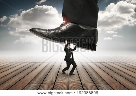 businessmen get overridden by underfoot on a heaven style background