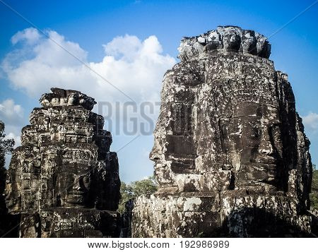 The stone faces of the Bayon in Siem Reap Cambodia.