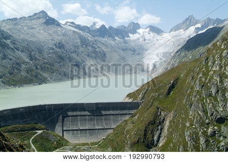 View of the Grimsel lake dam and the Oberaare glacier just below the Grimsel Pass in Switzerland