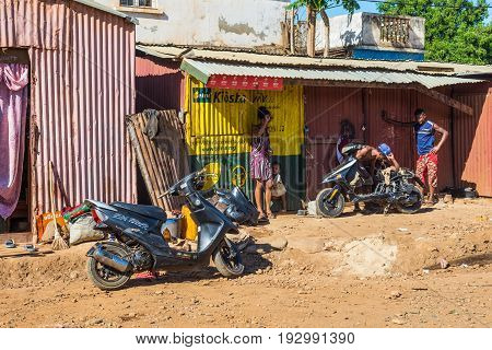 Antsiranana Madagascar - December 20 2015: Street scene with people and bikes in Antsiranana (Diego Suarez) north of Madagascar East African Islands Africa.