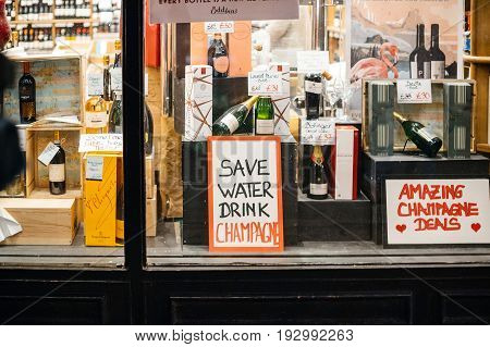 LONDON UNITED KINGDOM - CIRCA 2017: Alcohol grocery store pub bar with funny the message in the window