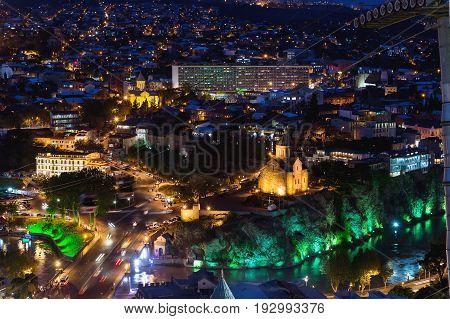 Night aerial view on Metekhi Church of the Dormition of the virgin. Monument to Vakhtang I Gorgasali. Famous landmarks in Tbilisi Georgia.