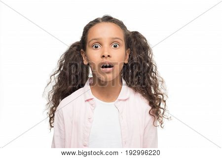 Shocked Little Girl Looking At Camera Isolated On White