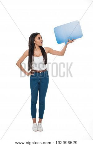 Surprised Woman With Hand On Hip Holding Speech Bubble Isolated On White