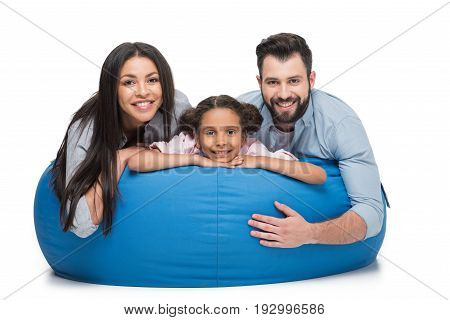 Cheerful Family Lying On Bag Chair Together And Looking At Camera Isolated On White