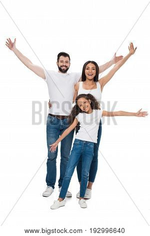 Smiling Family With Outstretched Arms Looking At Camera With Isolated On White
