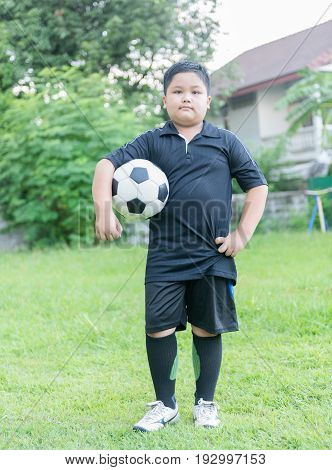 Standing Obese Fat Boy  Soccer Player With Football