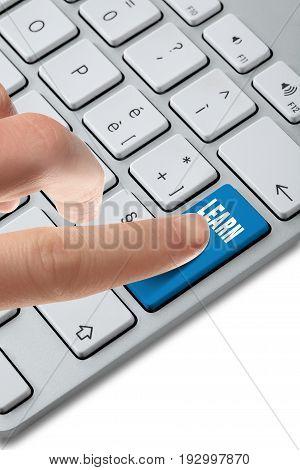 finger on an aluminium keyboard pushing on a button