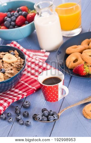 Breakfast with wholegrain cereals with coffee on wooden table.
