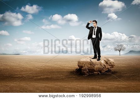 businessman abandoned alone in the hot desert poster