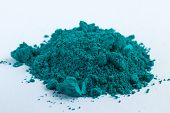 Cobalt Oxide Green Blue pigment on a white background, macro poster