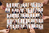 Businesspeople Hand Selecting The Candidate Portrait Photo For Hiring In Job poster