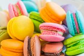 Colourful and sweet Macaroon or macaron on white background. macaron is a sweet confection made with egg white, icing sugar, granulated sugar, almond powder or ground almond, and food coloring. poster