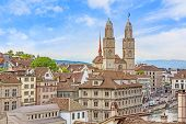 The Grossmunster with town hall in front. It is a Romanesque-style Protestant church in Zurich Switzerland. View from park Lindenhof. poster