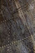 Old aluminum background detail of a military aircraft surface corrosion. Oxidized metal texture with rivets. poster