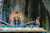 Indian Deity Statues decorating the Batu Caves from the outside Malaysia. The cave is one of the most popular Hindu shrines outside India poster