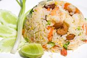 delicious seafood fried rice with shrimp crab eggs and a light garnishing of spring onions. served with traditional sauces. poster