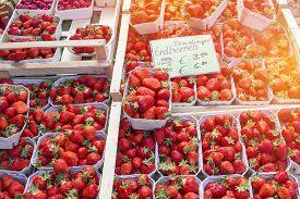 Organic strawberries shop at morning market.Vibrant color & Sun effect