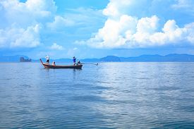 Long tail boat floating on the sea