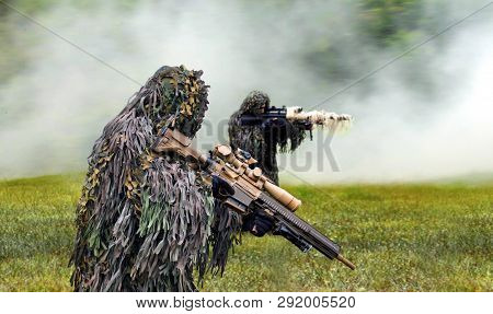 Military Commando Dressed In Ghillie Camouflage During  Combat Warfare