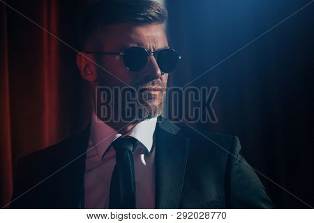 A close up portrait of a brutal handsome man in sunglasses. Men's beauty, fashion. Optics for men.