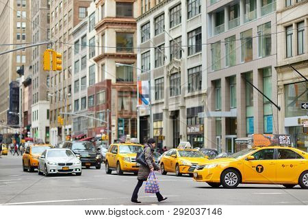 New York - March 16, 2015: Yellow Taxi Cabs And People Rushing On Busy Streets Of Downtown Manhattan
