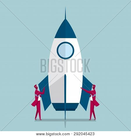 Aerospace Industry. Two Businessmen Are Standing On Both Sides Of The Rocket. Isolated On Blue Backg