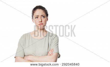 Unhappy Thoughtful Young Woman With Concerned Look On Her Face Contemplating A Problem - Isolated On