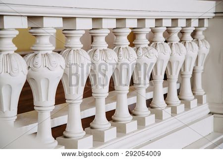 A Row Of White Concrete Balusters In The Castle. Baroque Style.