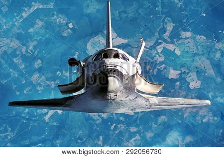 Spaceship On The Flight. Space Shuttle Close-up. Flying Rocket. View Of The Planet Earth  From Outer