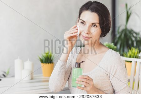 Makeup Remove Skin Care. Closeup Woman Holding Cotton Swab And Makeup Remover Liquid Cosmetic In Han