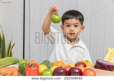 Healthy And Nutrition Concept. Kid Learning About Nutrition With Doctor To Choose Eating Fresh Fruit