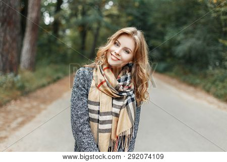 Pretty Happy Young Woman With A Stylish Hairstyle With A Beautiful Smile In A Spring Stylish Coat In