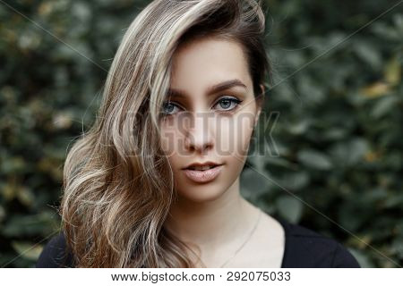 Portrait Of A European Attractive Young Woman With A Sweet Smile With Beautiful Blue Eyes With Blond