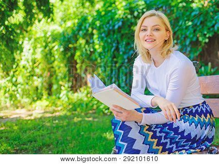 Woman Happy Smiling Blonde Take Break Relaxing In Garden Reading Poetry. Girl Sit Bench Relaxing Wit