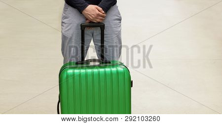 A Man Is Waiting For Deportation At The Airport. Deporting Of A Foreign Citizen. Voluntary Departure