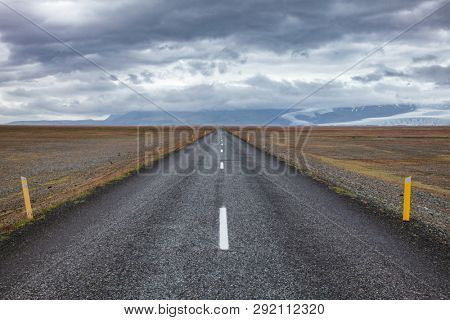 Route 1 or Ring Road (Hringvegur) national road that runs around the island and connecs popular tourist attractions in Iceland, Scandinavia. Fjallsjokull glacier tongue is seen in background