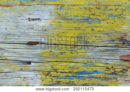 Old Painted Wooden Background. Colorful Wooden Texture. Cropped Shot Of Wooden Fence.  Wall Texture