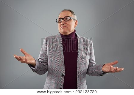 Adult man looking away and making helpless gesture poster