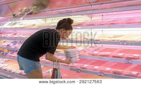 Bangkok, Thailand - March 24: Unidentified Customer Shops For Fresh Packaged Meat In The Meat Sectio