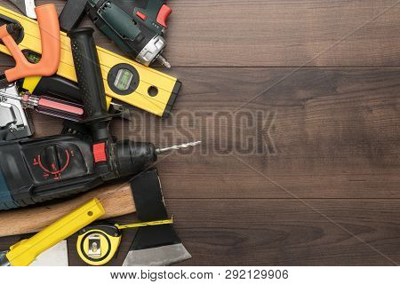 Construction Tools On Wooden Background. Different Tools With Copy Space. Diy Construction Tools On