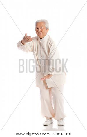 Chinese Elderly Woman Performing Tai Chi Isolated on White Background