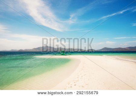 White Beach With Traditional Philippine Bangka Boat, Turquoise Water And Sandbar, Bulog Island, Phil