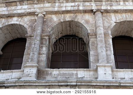 A Close Up Look At The Arch And Columns Of The Colosseum In Rome
