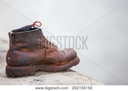 Budapest, Hungary - April, 2018: The Shoes On The Danube Bank A Memorial In Budapest Conceived By Fi